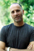 This image is of Yossi Ghinsberg a speaker who may be booked through Parliament Speakers for public speaking engagements